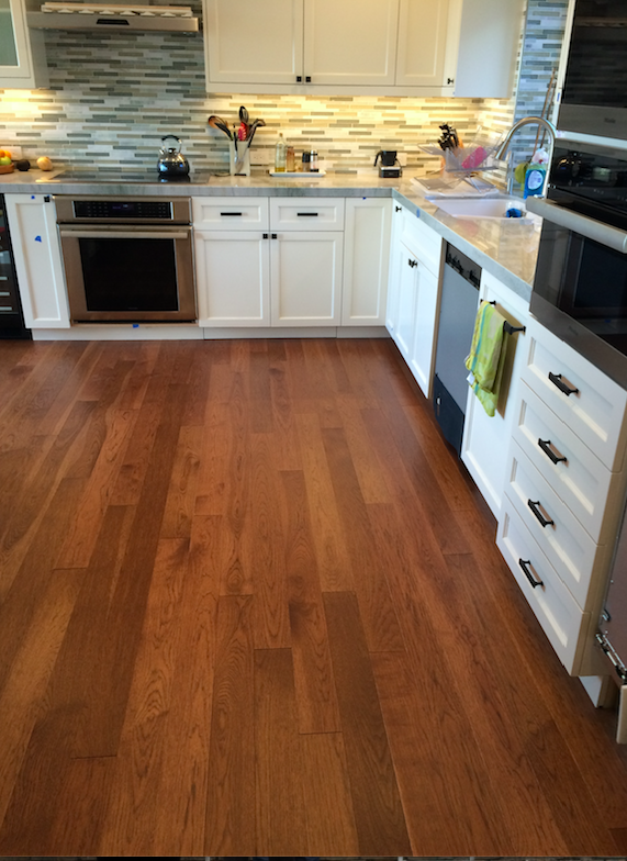 Hickory Hardwood Flooring in a white kitchen